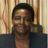 Ms. JOAN A. OTIENO, Commissioner