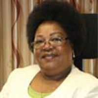 Dr. Mary C.  Mwiandi, Commissioner